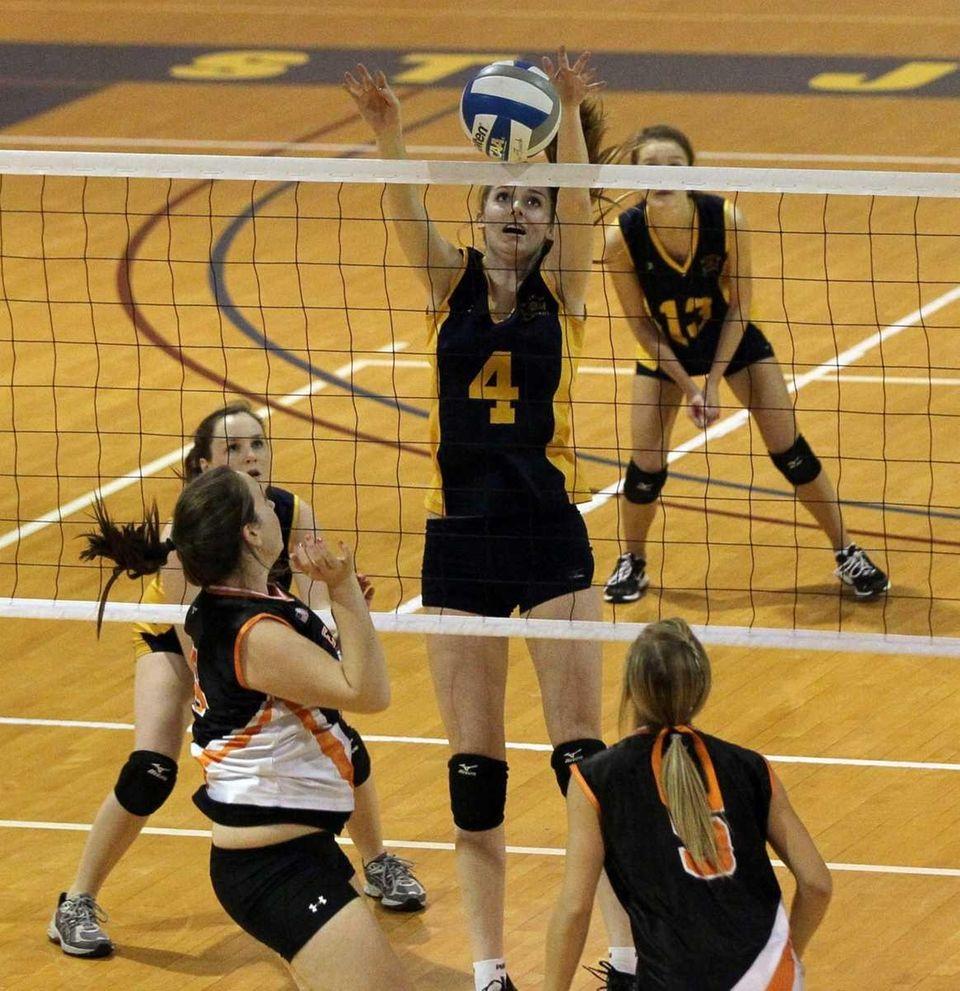 Clare Finnican #4 of Mattituck blocks a shot
