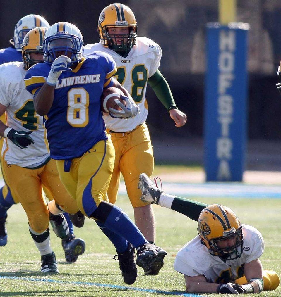 Lawrence's HS #8 Ryan Fredericks breaks a Lynbrook