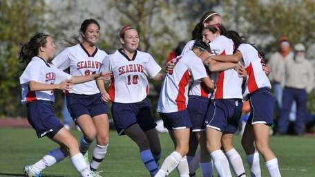 Alicia Roy of CSH, right, is mobbed by