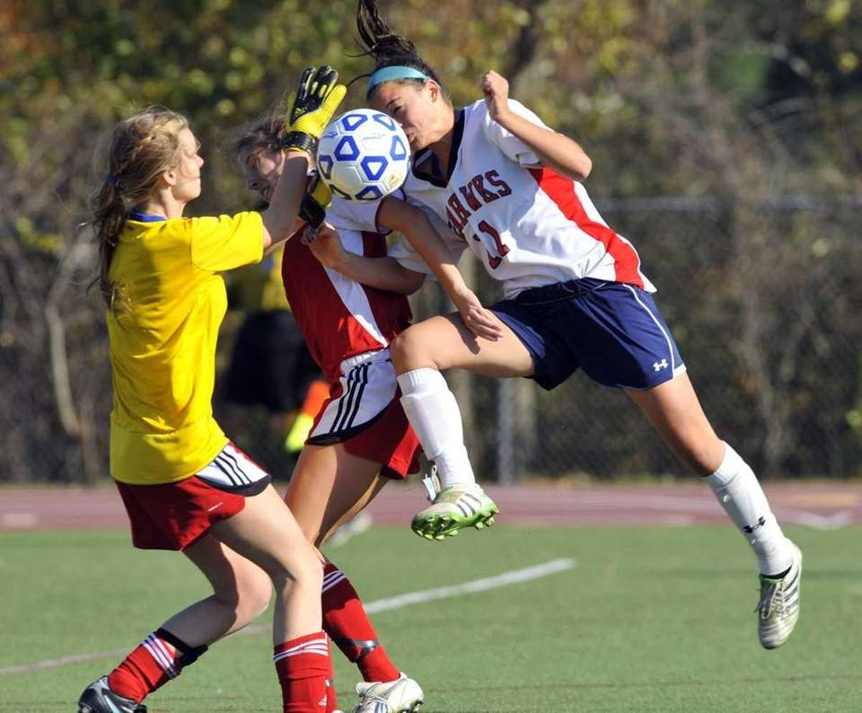 Chase Burke of CSH, right, tries to score