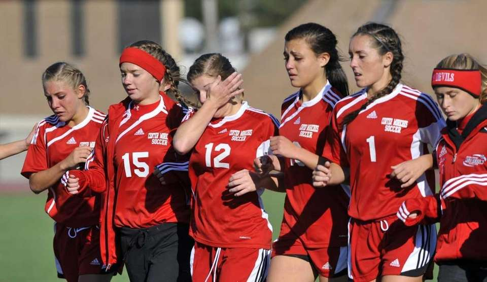 Center Moriches players cry and Brianna Mascia wipes