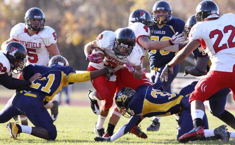 Newfield's Michael Silva gains yardage against West Babylon