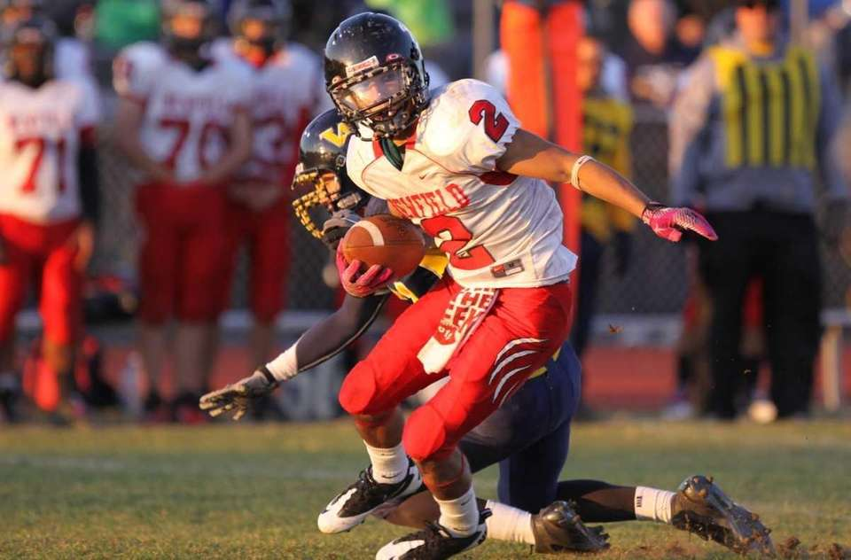 Newfield's Michael Silva eludes the tackle of West