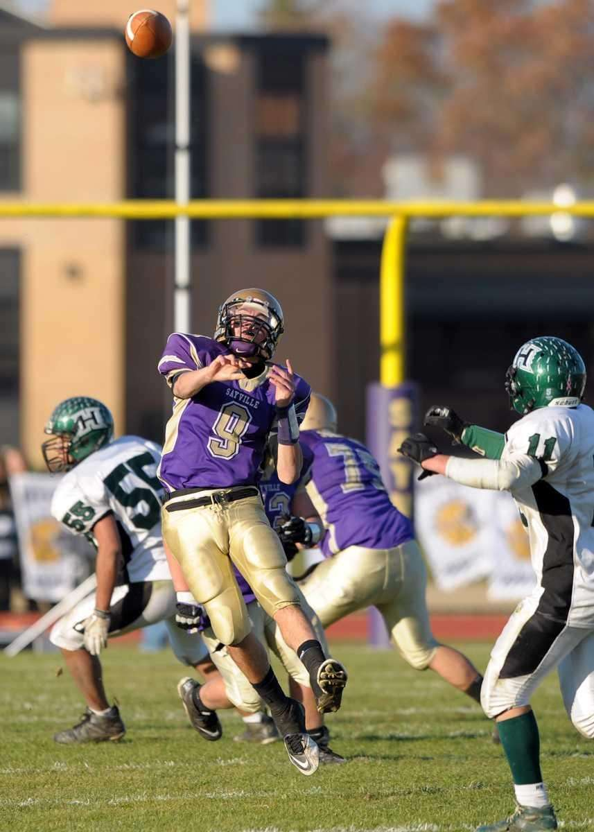 Sayville's Steven Ferreira throws a long pass to