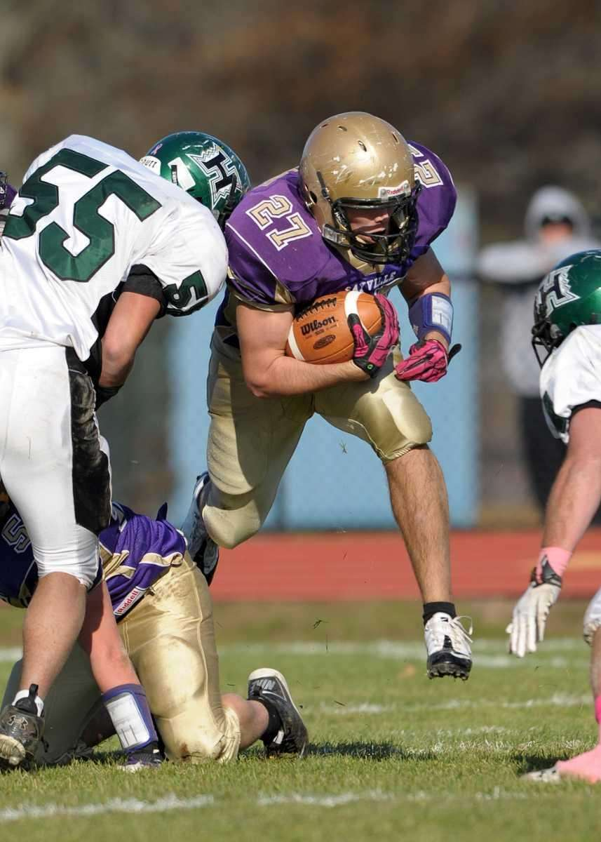 Sayville's John Haggart (27) runs through the defense