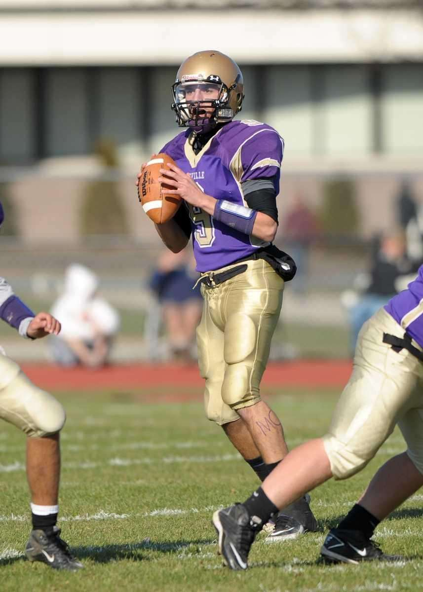 Sayville's Steven Ferreira looks to pass downfield during