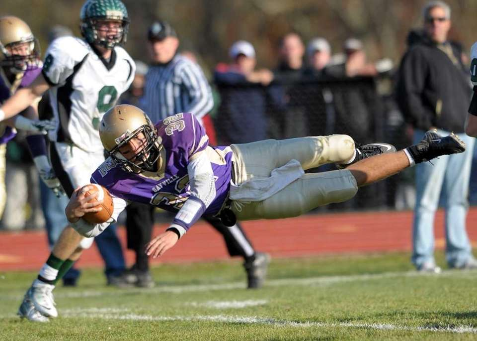 Sayville's Zachary Sirico (32) dives for the endzone