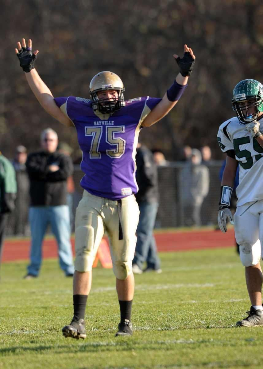 Sayville's Biilly Johnson (75) celebrates the score during