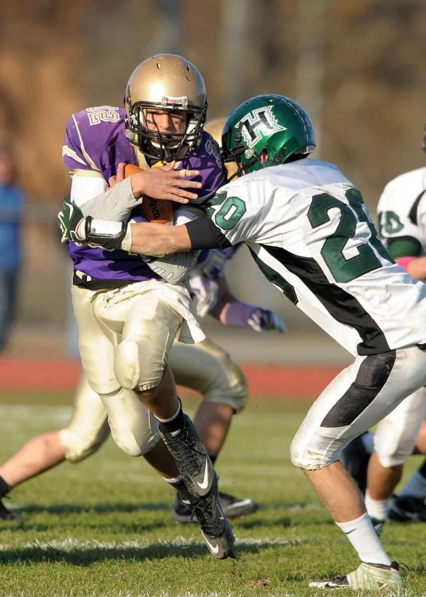 Sayville's Zachary Sirico (32) breaks through the Harborfields