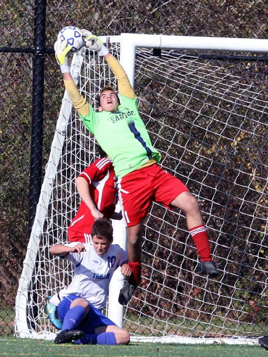 Wheatley's keeper Eric Orologio comes down with the