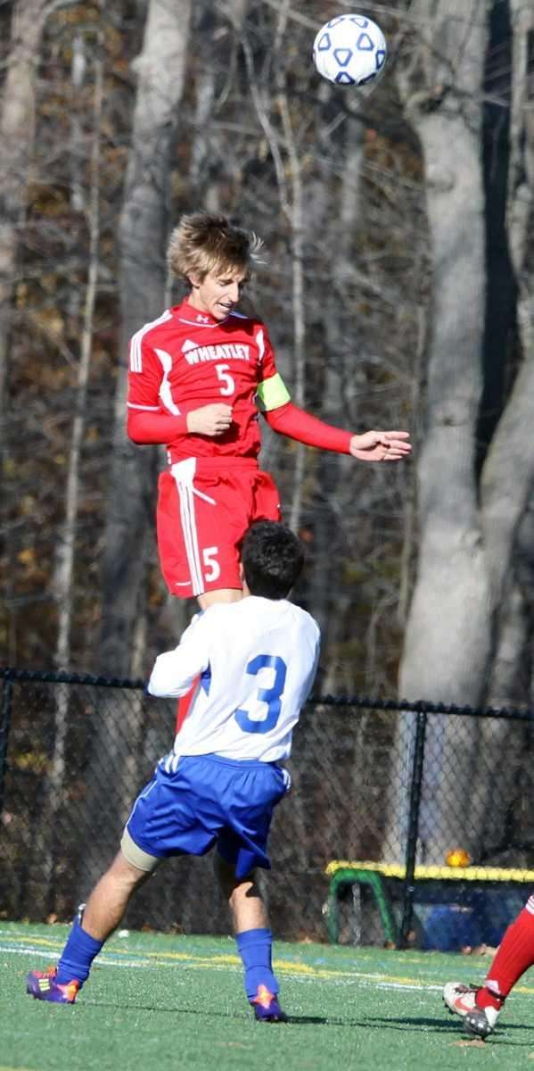 Wheatley's William Schiela jumps high for the header.