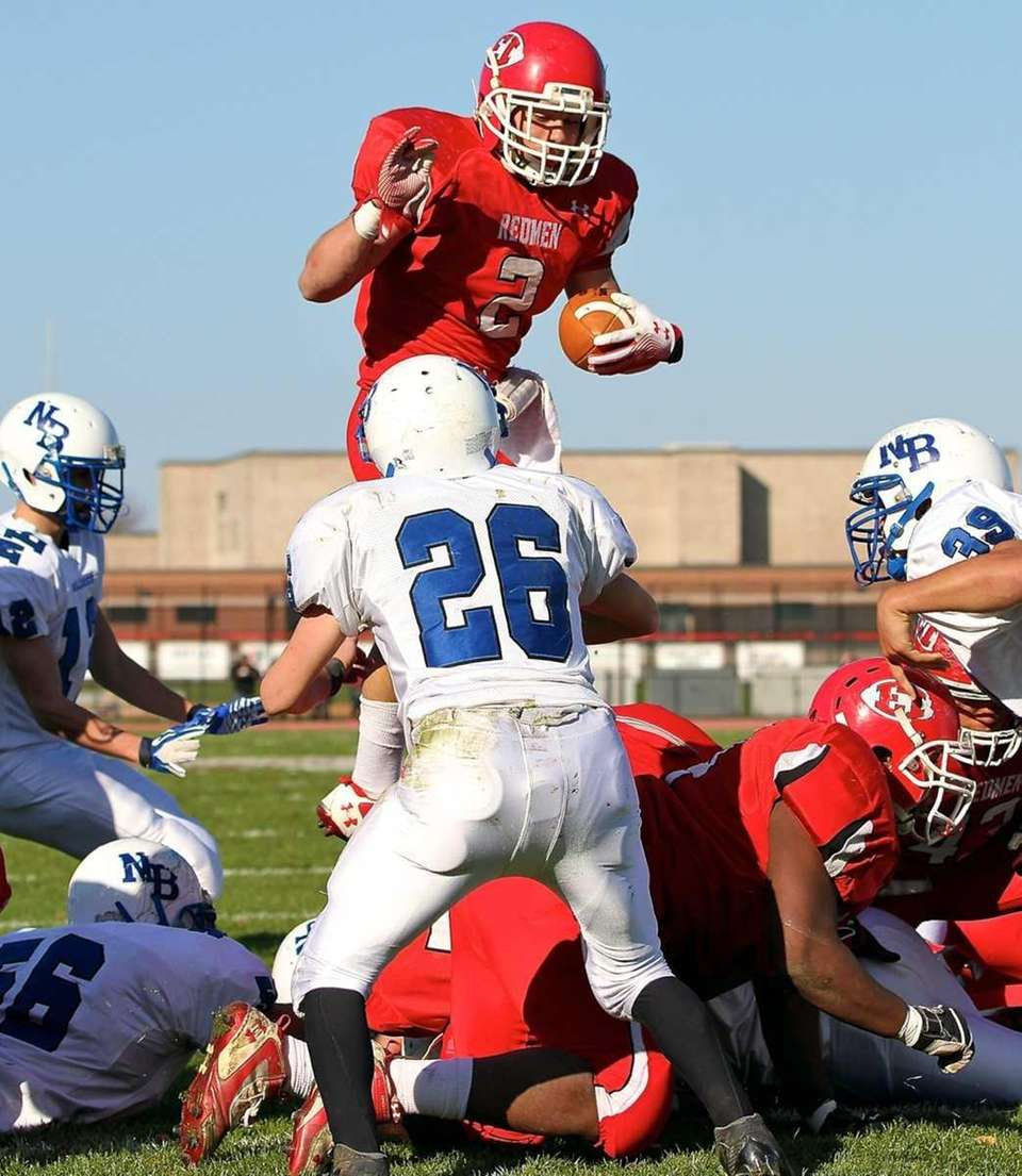 East Islip RB Tyler Rigo goes up and