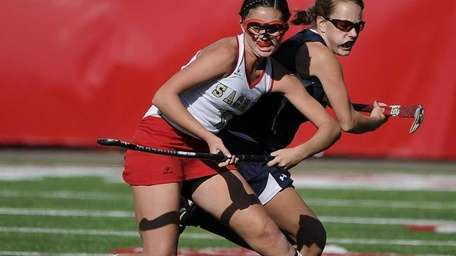 Sachem East's Katie Trombetta protects the ball from