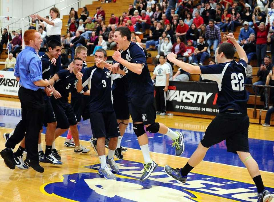 ESM's Ryan Brisson and teamates is ecstatic after