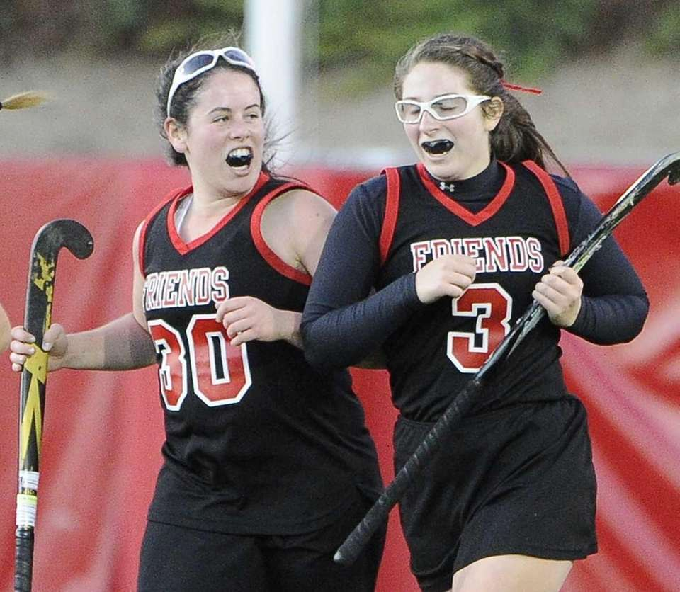 Friends Academy's Savannah Febesh, right, celebrates her goal