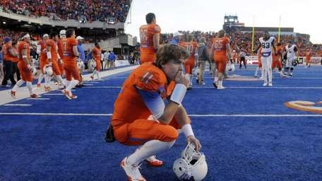 Boise State quarterback Kellen Moore reacts after losing