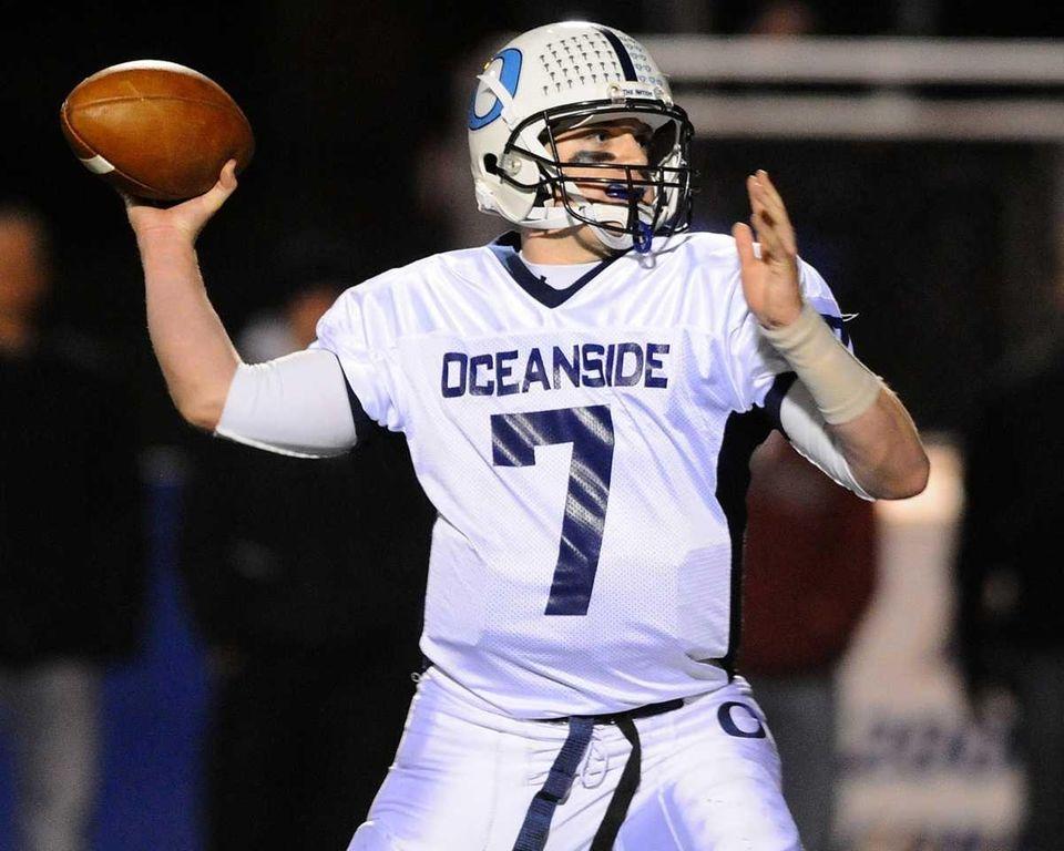 Oceanside High School quarterback #7 John Grassi throws
