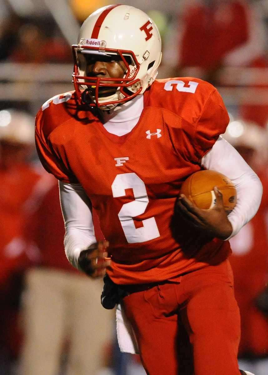 Freeport High School quarterback #2 Isaiah Barnes runs