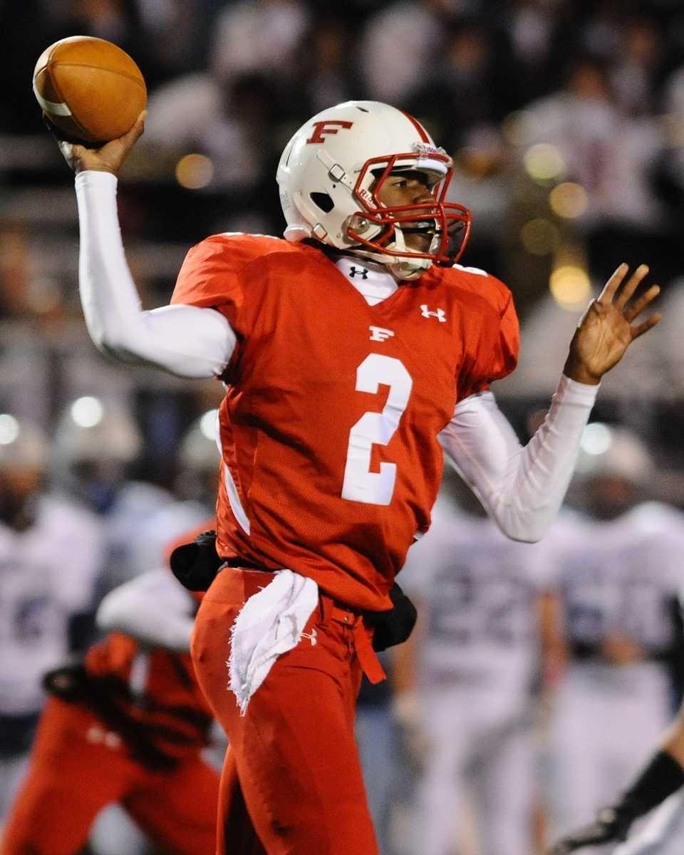 Freeport High School quarterback #2 Isaiah Barnes throws