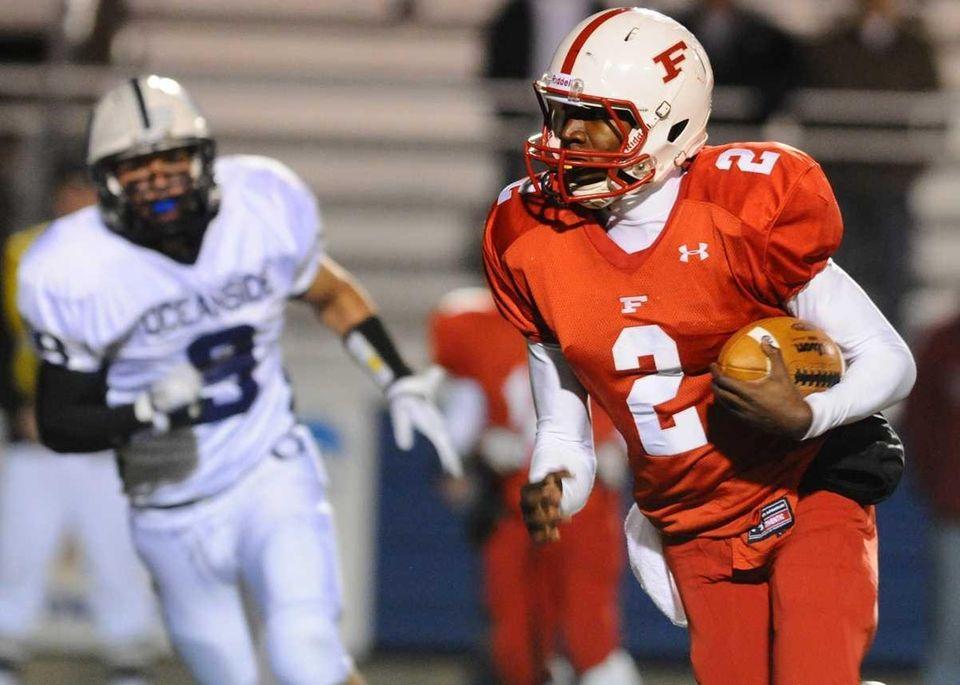 Freeport High School quarterback #2 Isaiah Barnes scrambles