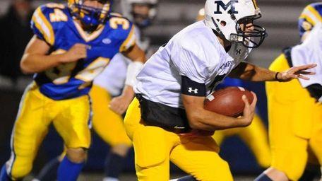 Massapequa High School quarterback #7 Matt Pagano runs