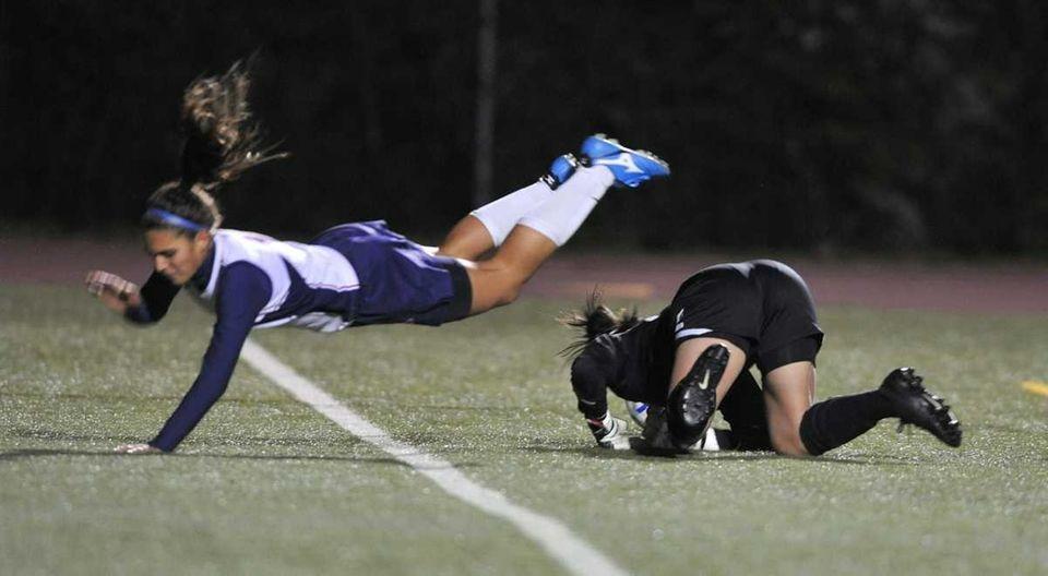 MacArthur's Arianna Montefusco flies over Ward Melville goalkeeper