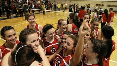 Smithtown East celebrates after defeating Massapequa during the