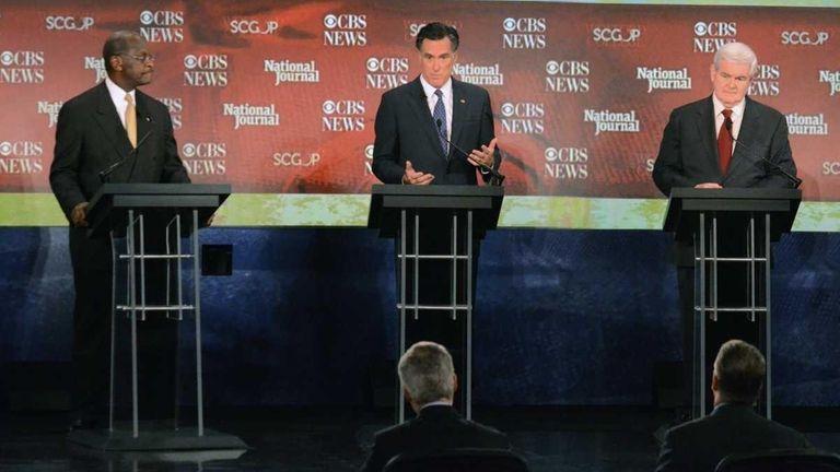 Republican presidential candidate Herman Cain, left, Mitt Romney,