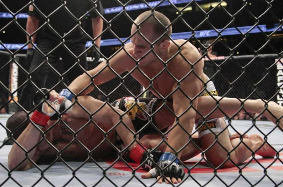 Junior dos Santos, right, of Brazil, takes down