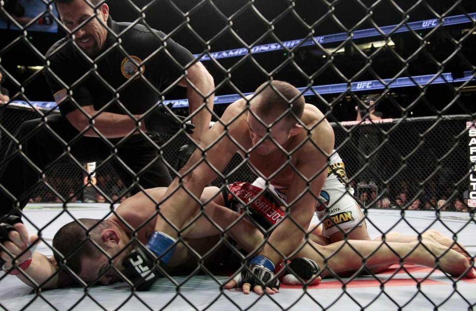 Junior dos Santos, top right, takes down Cain