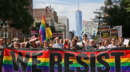 Marchers participate in the Queer Liberation March in