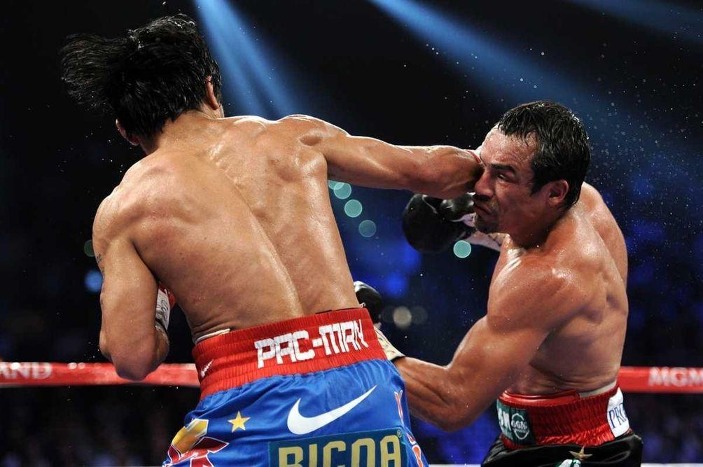 Juan Manuel Marquez, right, prepares to throw a