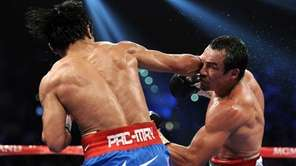 Juan Manuel Marquez, right, prepares to throw a