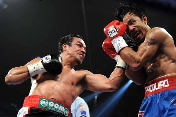 Juan Manuel Marquez, left, throws a left to