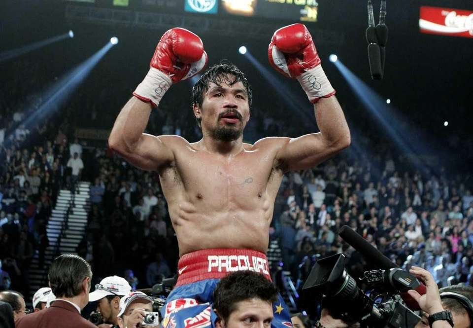 Manny Pacquiao celebrates after his victory over Mexico's