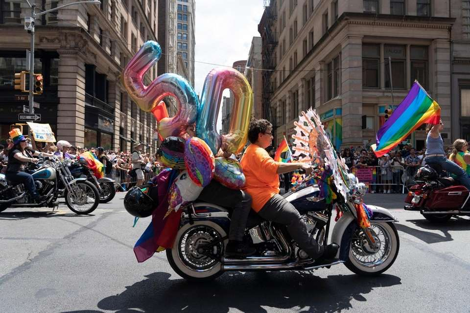 Participants in the NYC Pride March ride motorcycles