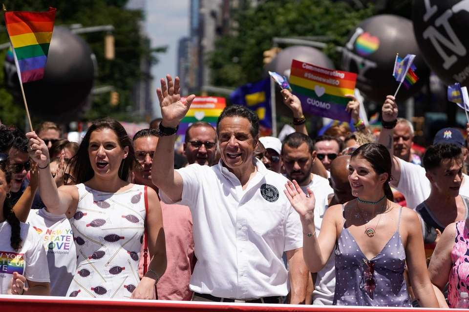 New York State Governor Andrew Cuomo marches in