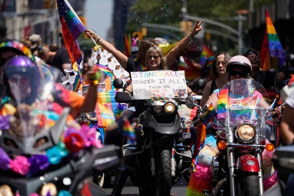 Participants ride motorcycles on Fifth Avenue during the