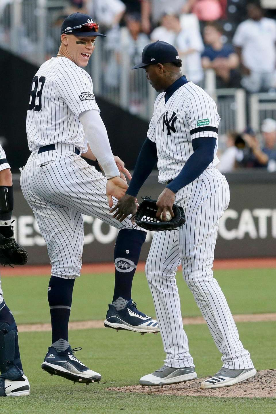 Yankees right fielder Aaron Judge, left, and relief