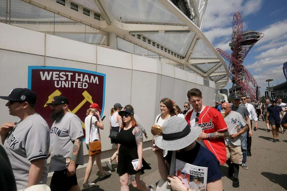 Fans arrive at London Stadium for a baseball