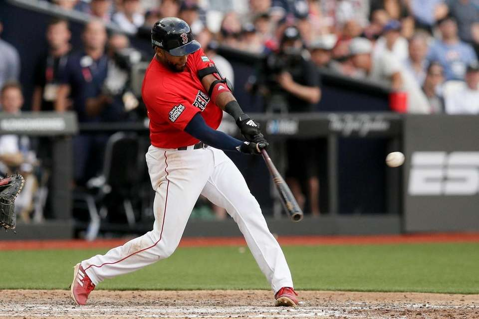 Boston Red Sox's Eduardo Nunez hits a RBI-single