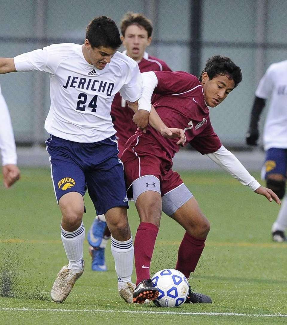 Jericho's Michael Blumberg battles for possession with East