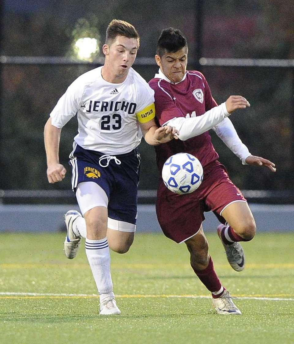 Jericho's Harrison Reiber fights for possession with East