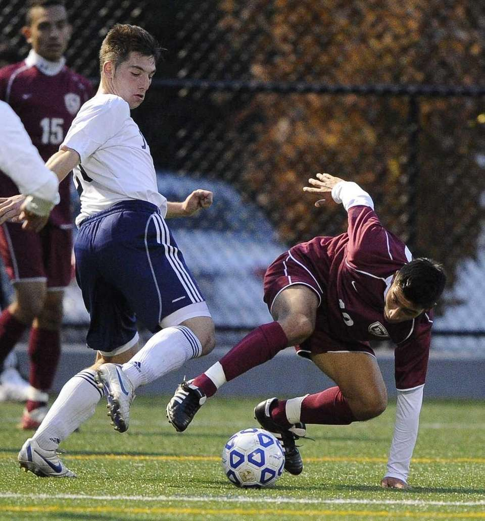 Jericho's Harrison Reiber battles for possession with East