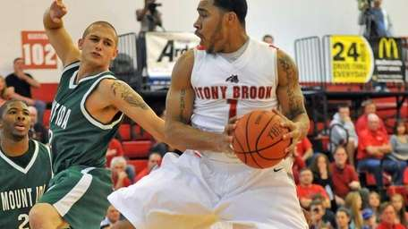 Stony Brook Ron Bracey grabs a rebound as