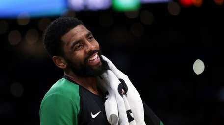 Boston Celtics guard Kyrie Irving smiles as he