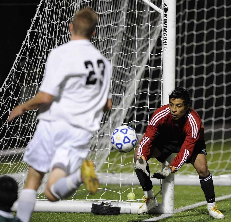 Brentwood's Raul Bonilla saves a shot on goal