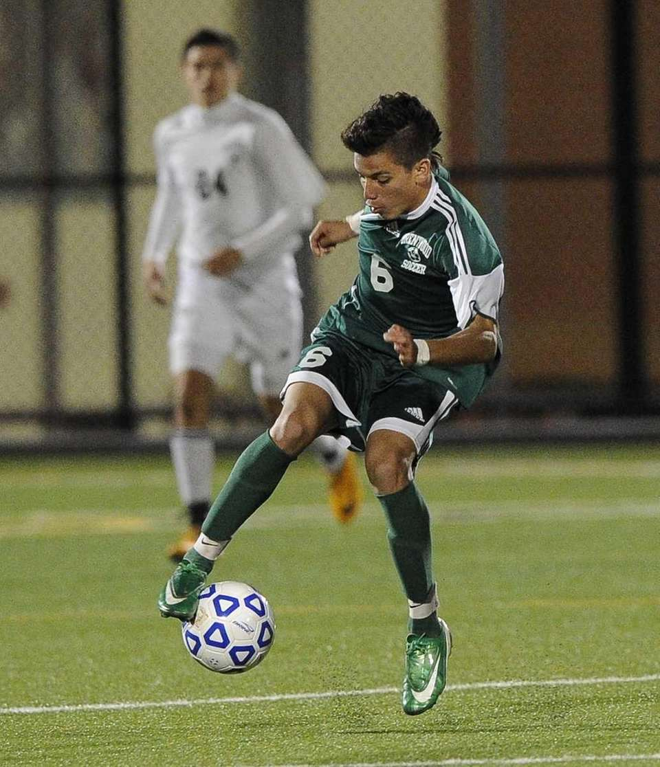 Brentwood's Ever Torres controls the ball against Hicksville