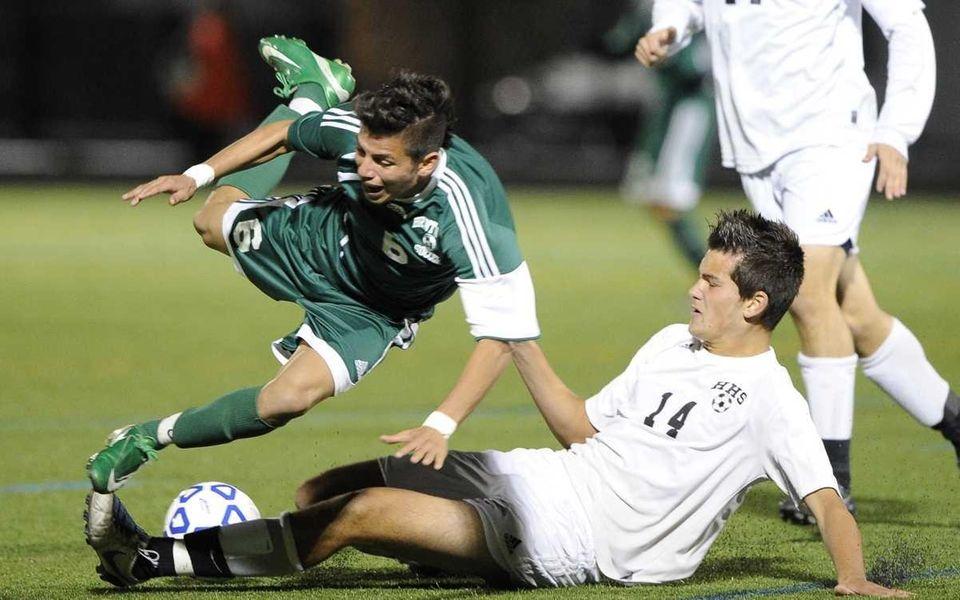Hicksville's Kyle Brennan slide tackles the ball away