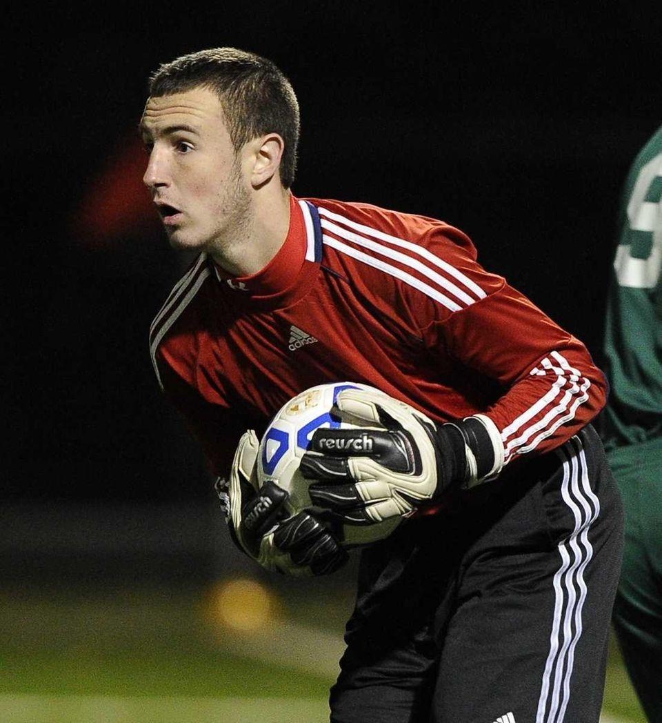 Hicksville goalkeeper Brian McPartland makes a save against